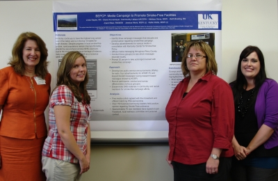 Leaders of the Breathe Easy Perry County program stand with their poster presentation at the CCTS Annual Conference