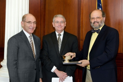 UK President Eli Capilouto and G.T. Lineberry, associate provost for faculty advancement, present the 2013 Albert D. and Elizabeth H. Kirwan Memorial Prize to Sidney W. Whiteheart, professor of molecular and cellular biochemistry in the UK College of Medicine.
