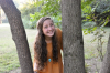 A photo of Hannah Thomas between trees.